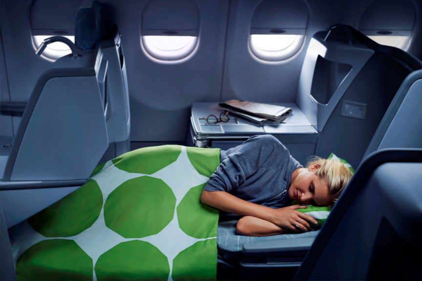 Finnair business woman sleeping
